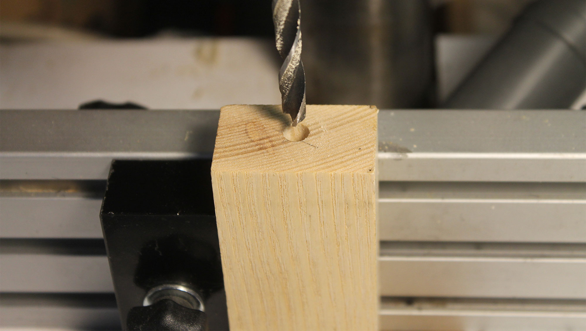 The off-center clamping block.