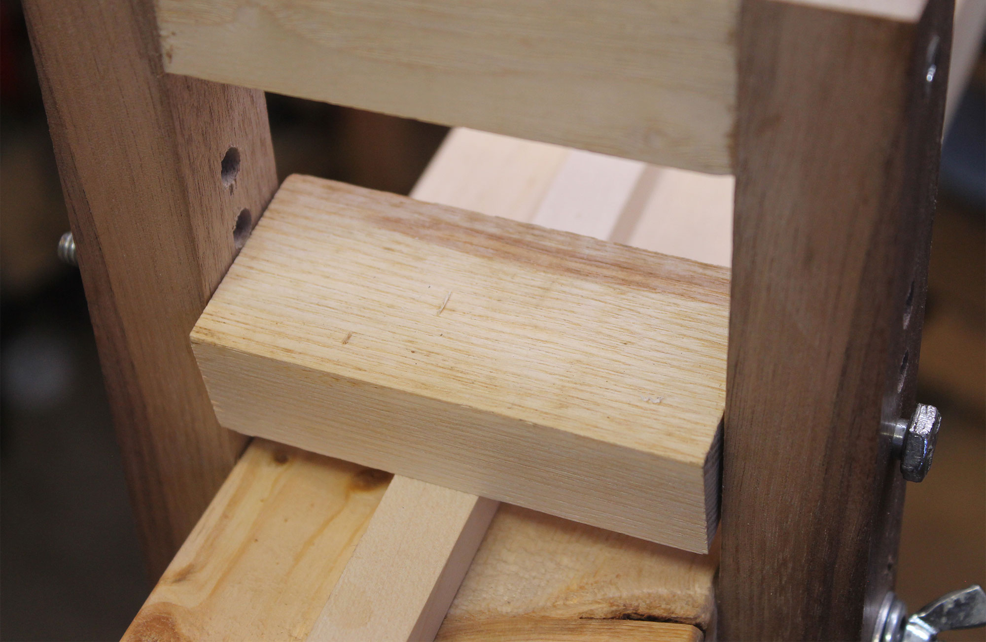 Installing the beam and clamping block to the fixture.