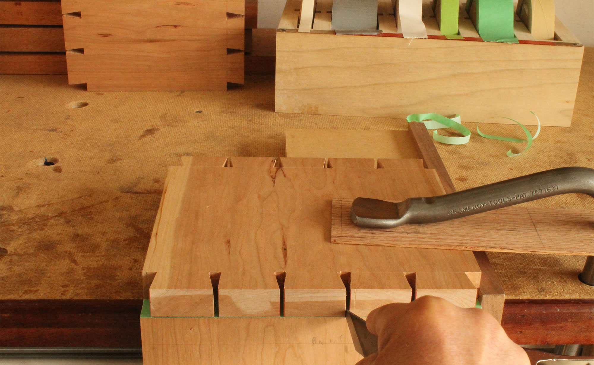 Using tape to help cut dovetails.
