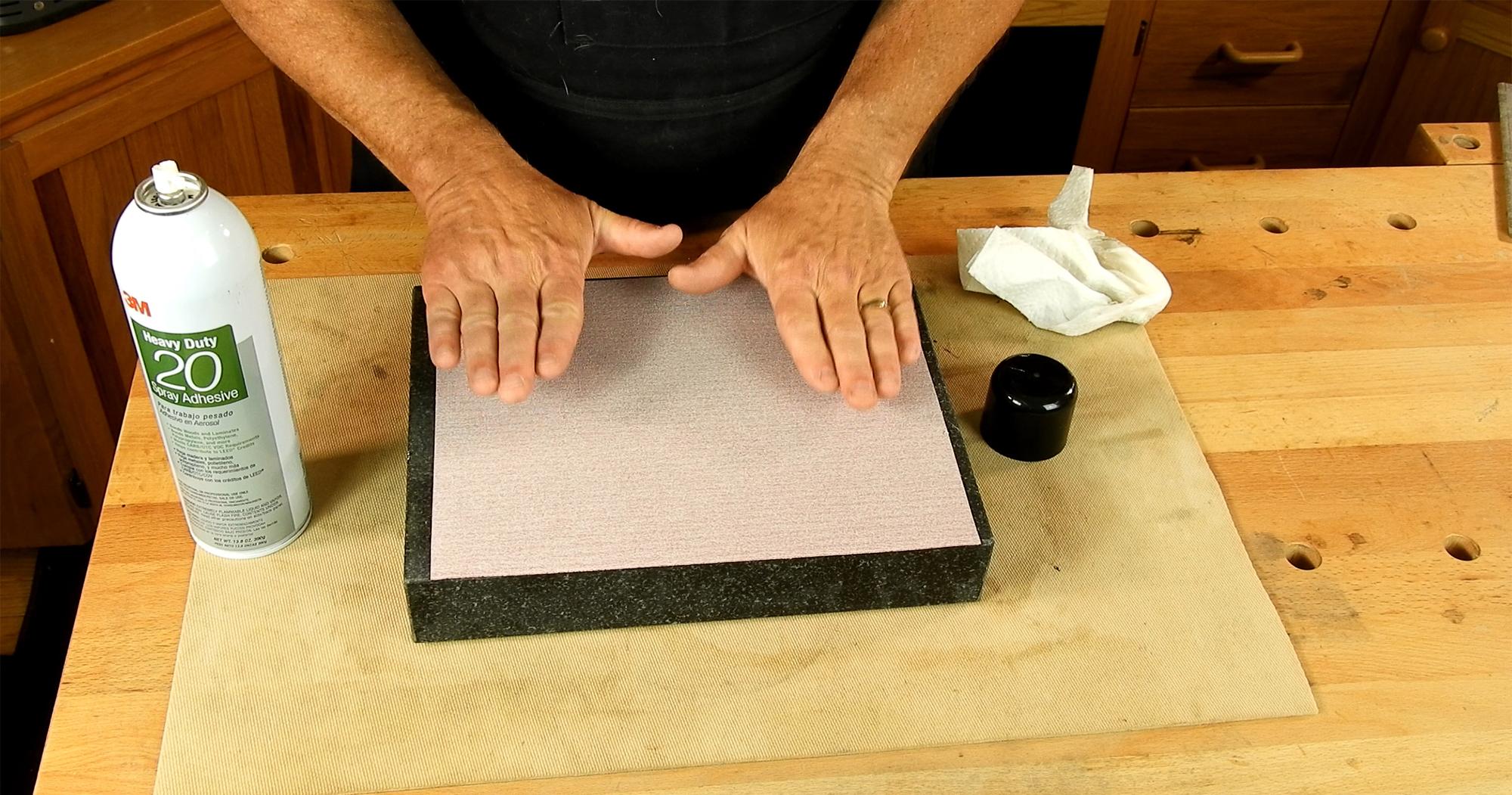 Sticking paper to granite.