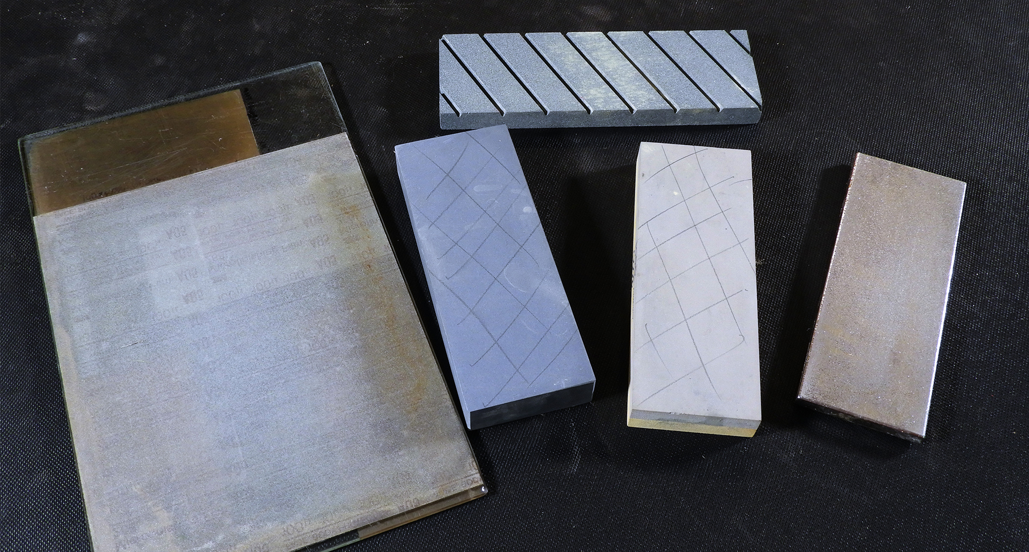 Selection of flattening media – Abrasive on glass (left), Truing stone (top) and diamond stone (right)