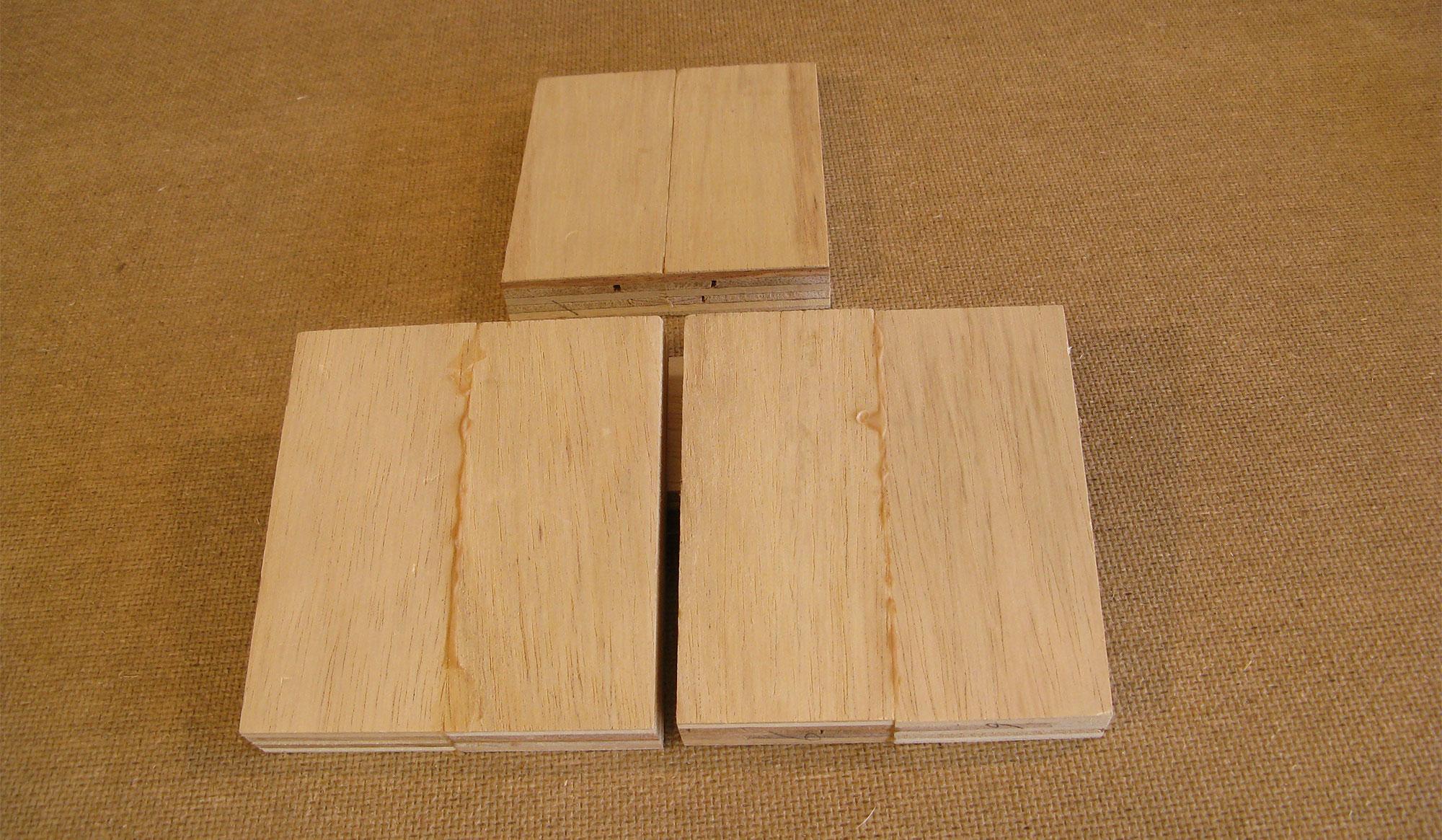 Three glued wooden blocks.