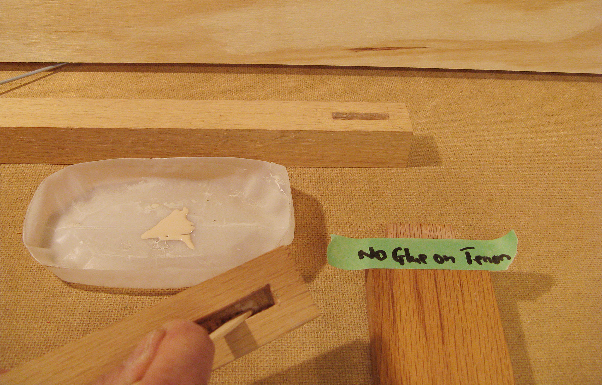 Applying glue to mortise.