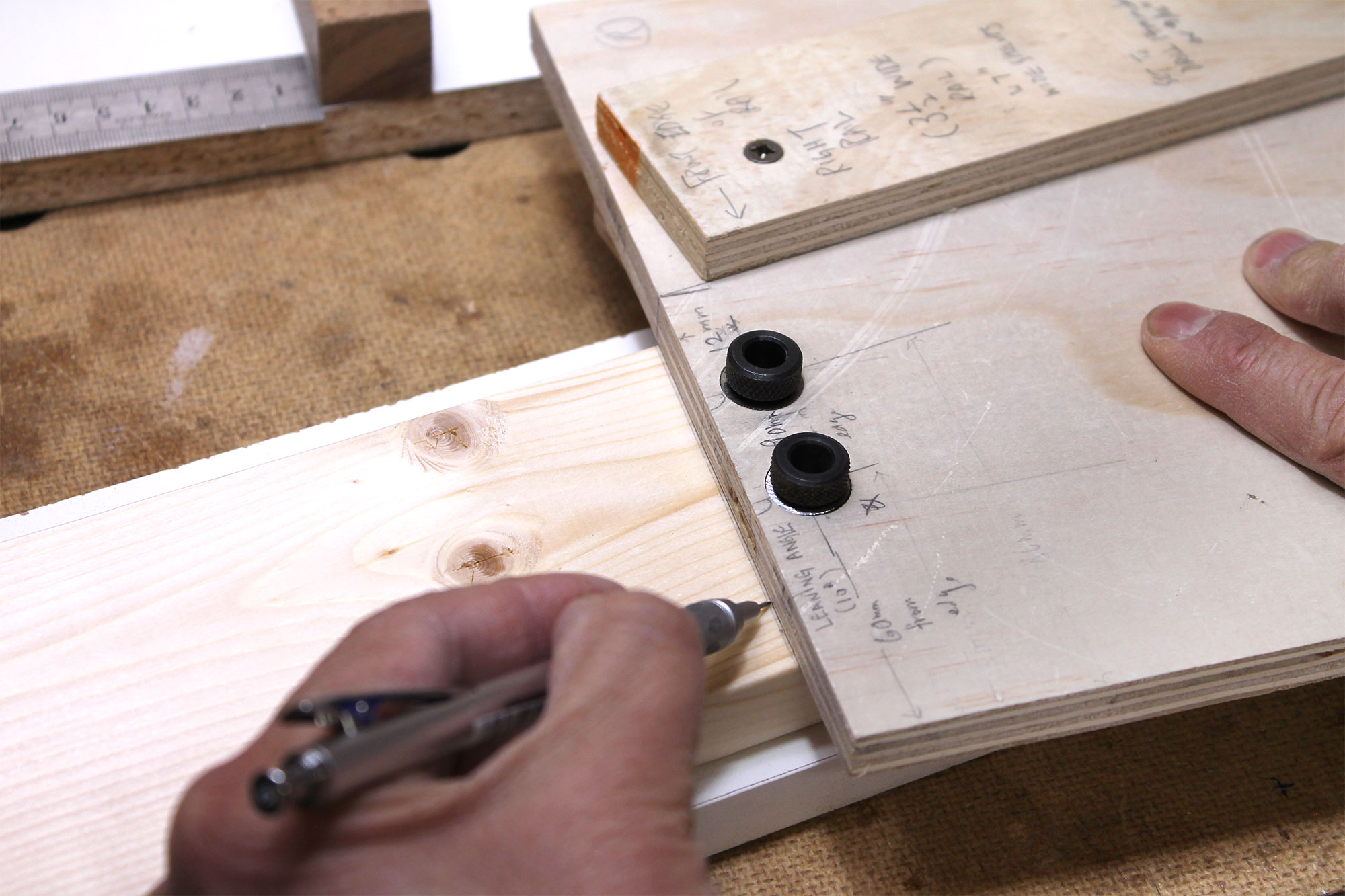 Using the top edge of the jig to lay out a new line.