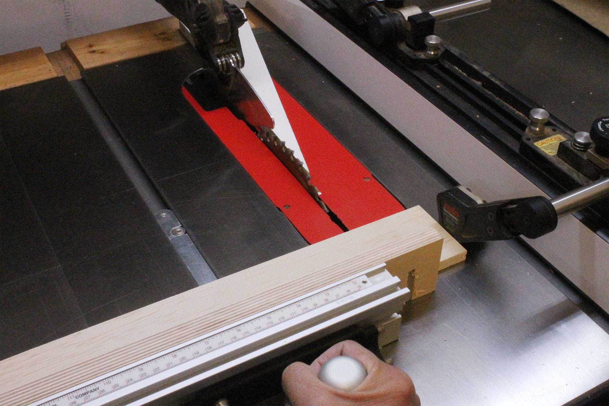Using a stop block on the saw fence.