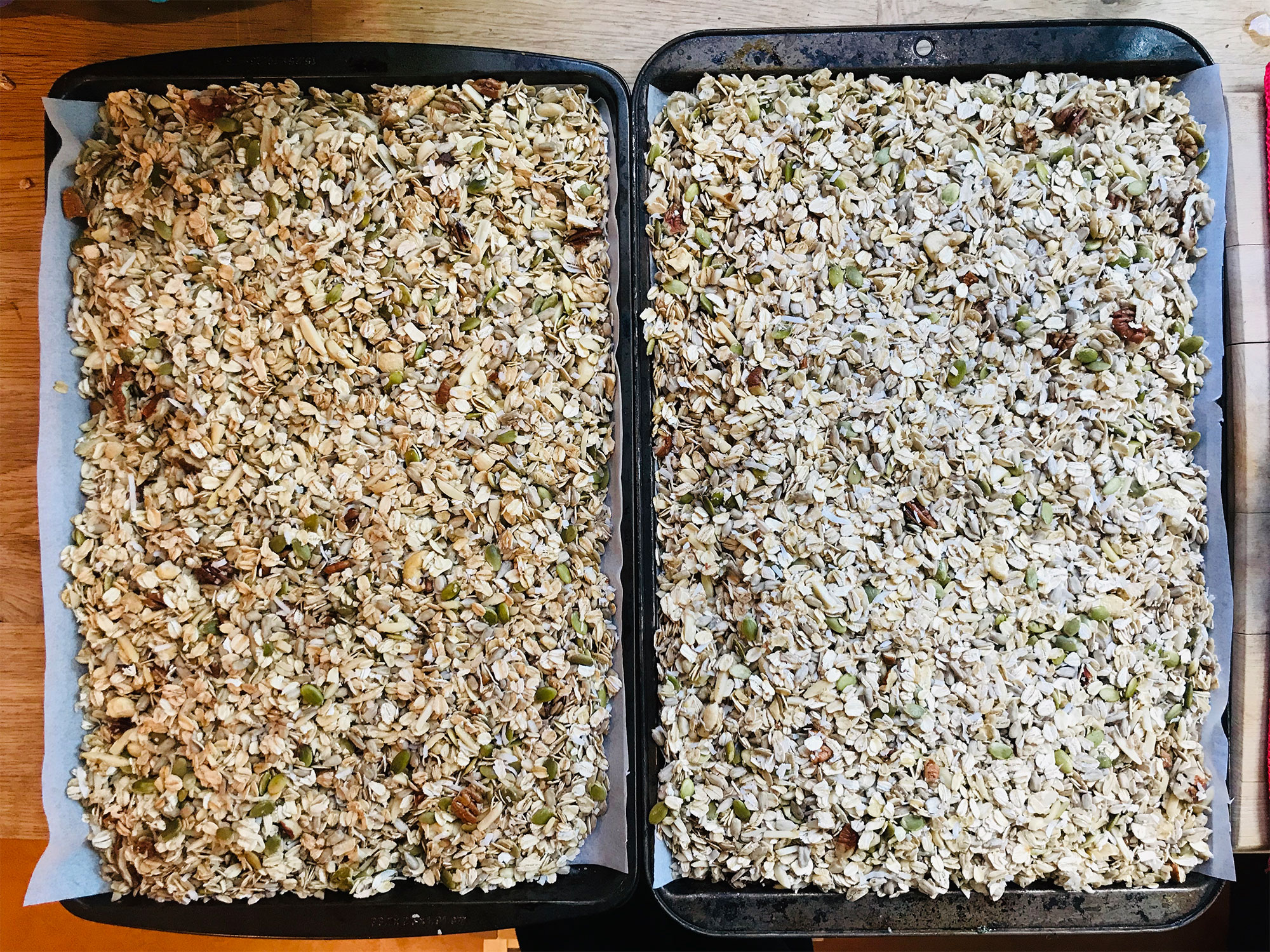 Granola spread on sheet pans ready for the oven
